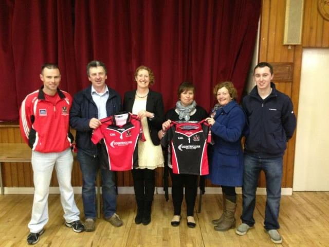 Dave & Mary O'Regan of Country Clean sponsoring the club jersays