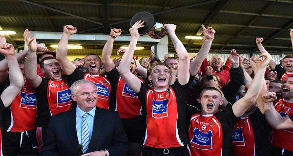 Brian O Reilly lifts the County Cup